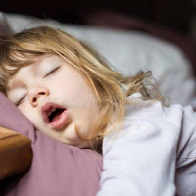 Child sleeping with mouth open